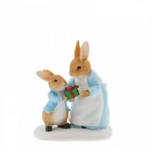 Mrs. Rabbit Passing Peter Rabbit a Present Figurine
